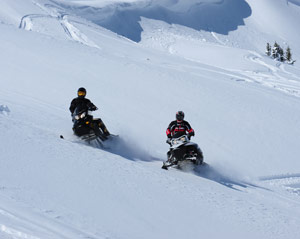Snowmobilers learning proper trail access
