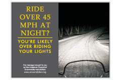 Horizontal Poster of Snowmobilers and text 'Ride Over 45 MPH at Night. You're Likely Over Riding Your Lights'