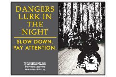 Horizontal Poster of Snowmobilers and text 'Dangers Lurk In The Night. Slow Down. Pay Attention'