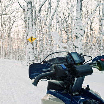 Snowmobiler approaching trail